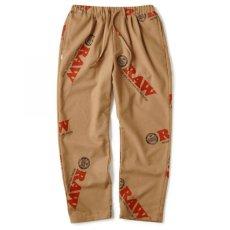 画像1: × Raw Logo Textile Trouser Lt Brown Pants コーデュロイ イージー パンツ ローリング ペーパー RAWペーパー 総柄 タックパンツ コラボレーション  (1)